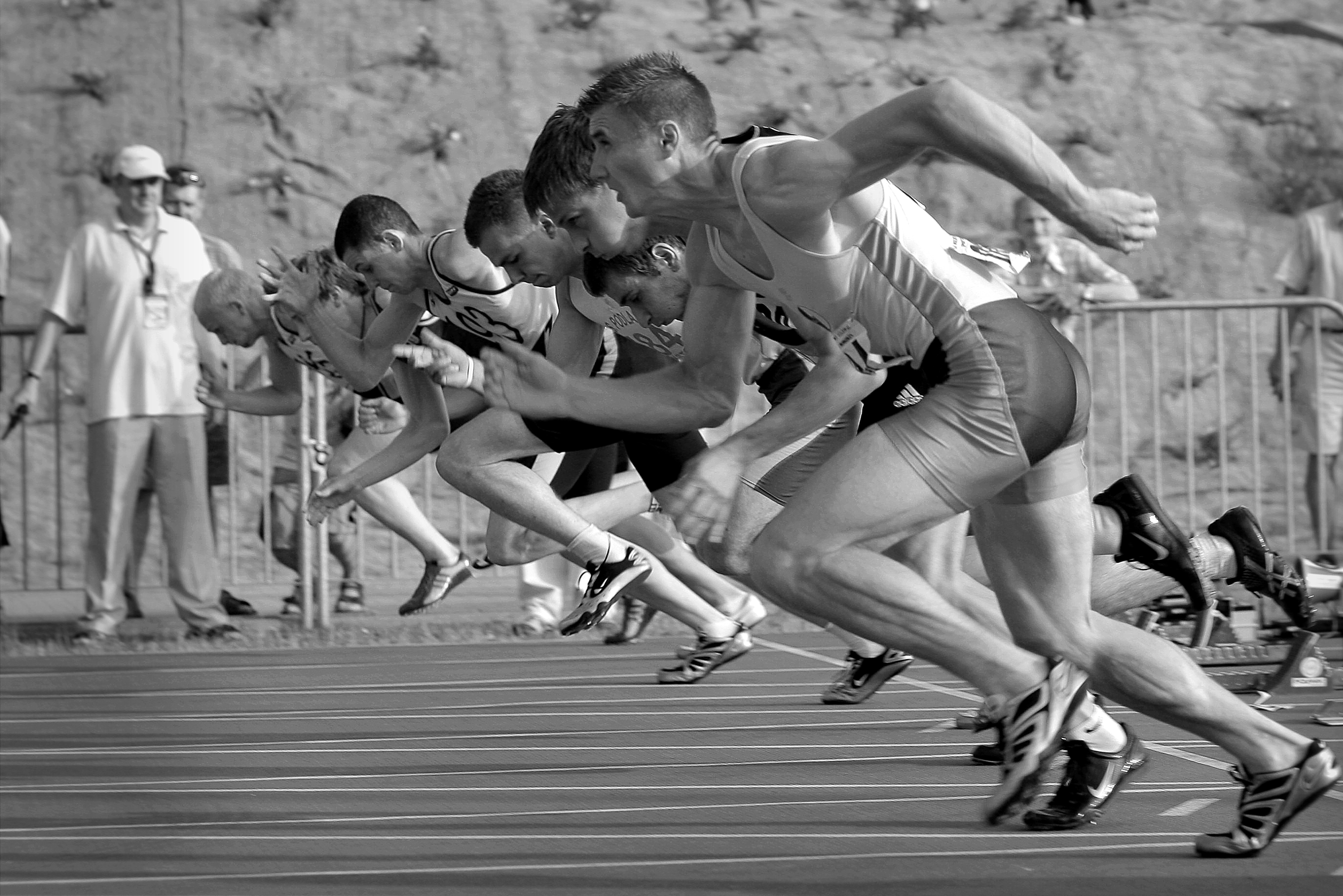 athletes on a race in black and white